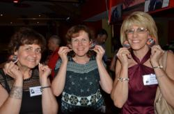 Niki Kavoures, Cindy Leonard & Karen Kidwell making earrings out of the car coasters